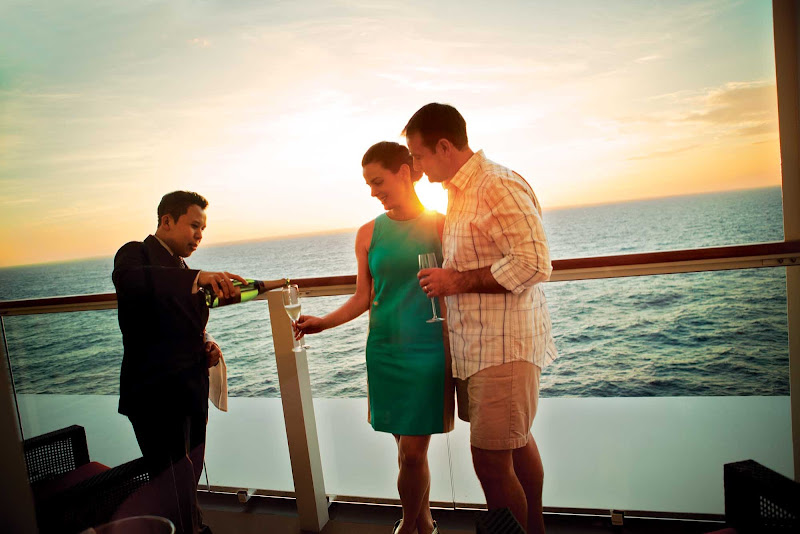 A butler serves Champagne to a couple on a Norwegian Cruise Line sailing.