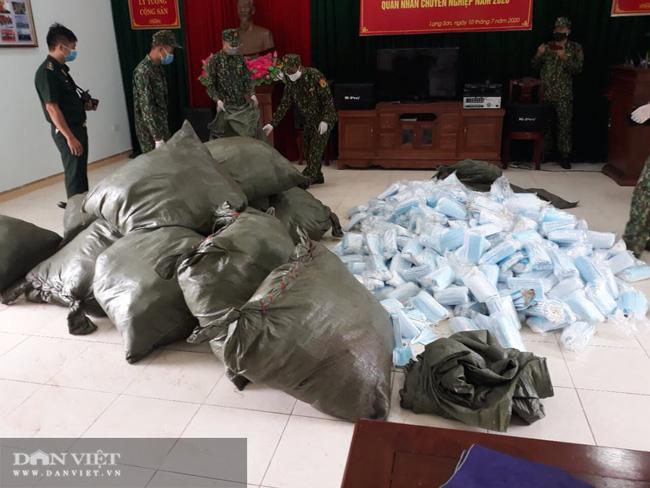 Lạng Sơn: Bắt giữ 27 người nhập cảnh trái phép, thu giữ 90.000 khẩu trang lậu - Ảnh 3