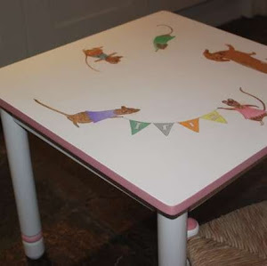 a kids table with mice painted on it