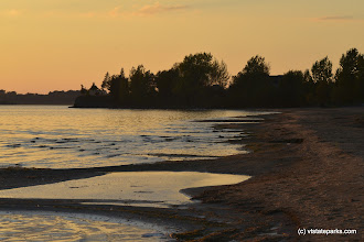 Photo: The shore at sunset at Alburg Dunes State Park