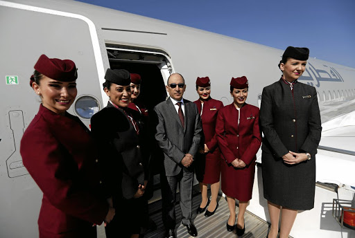 Qatar Airways CEO Akbar al-Baker poses with cabin crew at the Eurasia Airshow in Antalya, Turkey, on April 25 2018. Picture: REUTERS