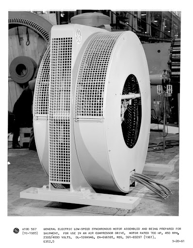 General Electric low-speed synchronous motor assembled and being prepared for shipment. Fir use in an air compressor drive. Motor rated 700 HP, 450 RPM, 2300/4000 Volts. DL-109X946, EN-696181, Req. 391-83297.