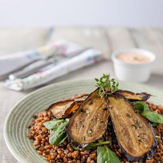 Wheat berry & Puy lentil salad with oven-roasted aubergine & Harissa-yogurt dressing