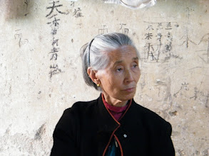 Photo: my old mother, in family name Hu, anxiously about my staying home upon my hometown journey.