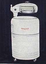 Photo: One of Hotpoint's washers, with a wringer on top. In the 50's, my mother's washer was also round, stood on high legs, and had a lid that lifted off. Her's had spin-dry, though, no wringer.