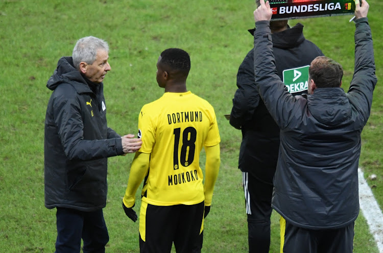 Borussia Dortmund coach Lucien Favre dishes out final instructions to strike Youssoufa Moukoko as he comes on as a substitute to replace four-goal hero Erling Braut Haaland.