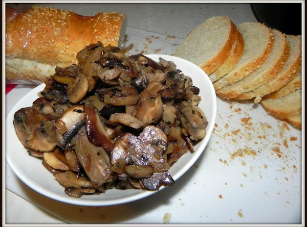 Serve the wild mushrooms in a small bowl along side of sliced country French...