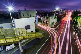 Photo: Cars zoom past beneath a pedestrian overpass in Matsudo, Japan