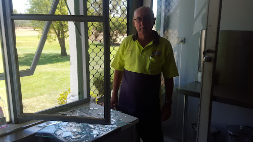 DAMAGE: Wee Waa Golf Club president David Russell inspects the result of some of the vandalism at the Wee Waa Golf Club, inset, some of the other damage and below, damage to the bar area.