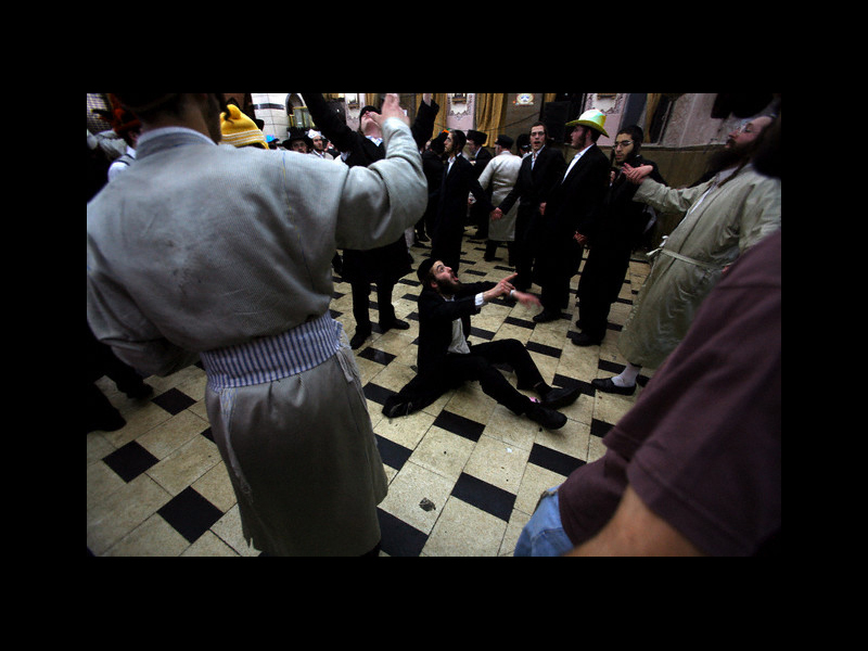 Photo: 05 Mar 2007, JERUSALEM, Israel --- Jewish ultra orthodox celebrate during the Jewish holiday of Purim at the street in Beney Brak, near Tel Aviv.  Purim is a celebration of the Jew's salvation from genocide in ancient Persia.   --- Image by © PAVEL WOLBERG/epa/Corbis