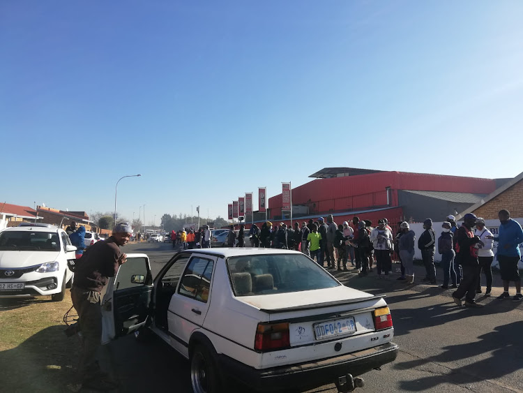 More than 100 people are gathered outside Supa store in Thokozoza Park, Soweto. Many say they are there to purchase alcohol, saying the ban was unnecessary to begin with.