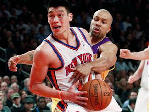 Photo: New York Knicks' Jeremy Lin (17) spins past Los Angeles Lakers' Derek Fisher (2) during the first half of an NBA basketball game, Friday, Feb. 10, 2012, in New York. (AP Photo/Frank Franklin II)