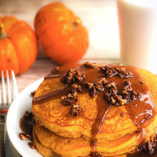 Pumpkin Pancakes with Caramel Maple Syrup and Candied Pecans.