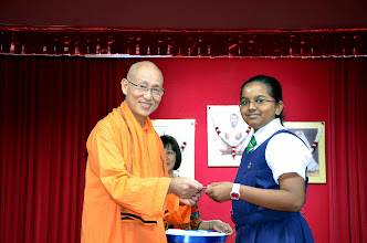 Photo: Kowsalya Ganesan who did well in PSLE, receiving the Award from Swamiji