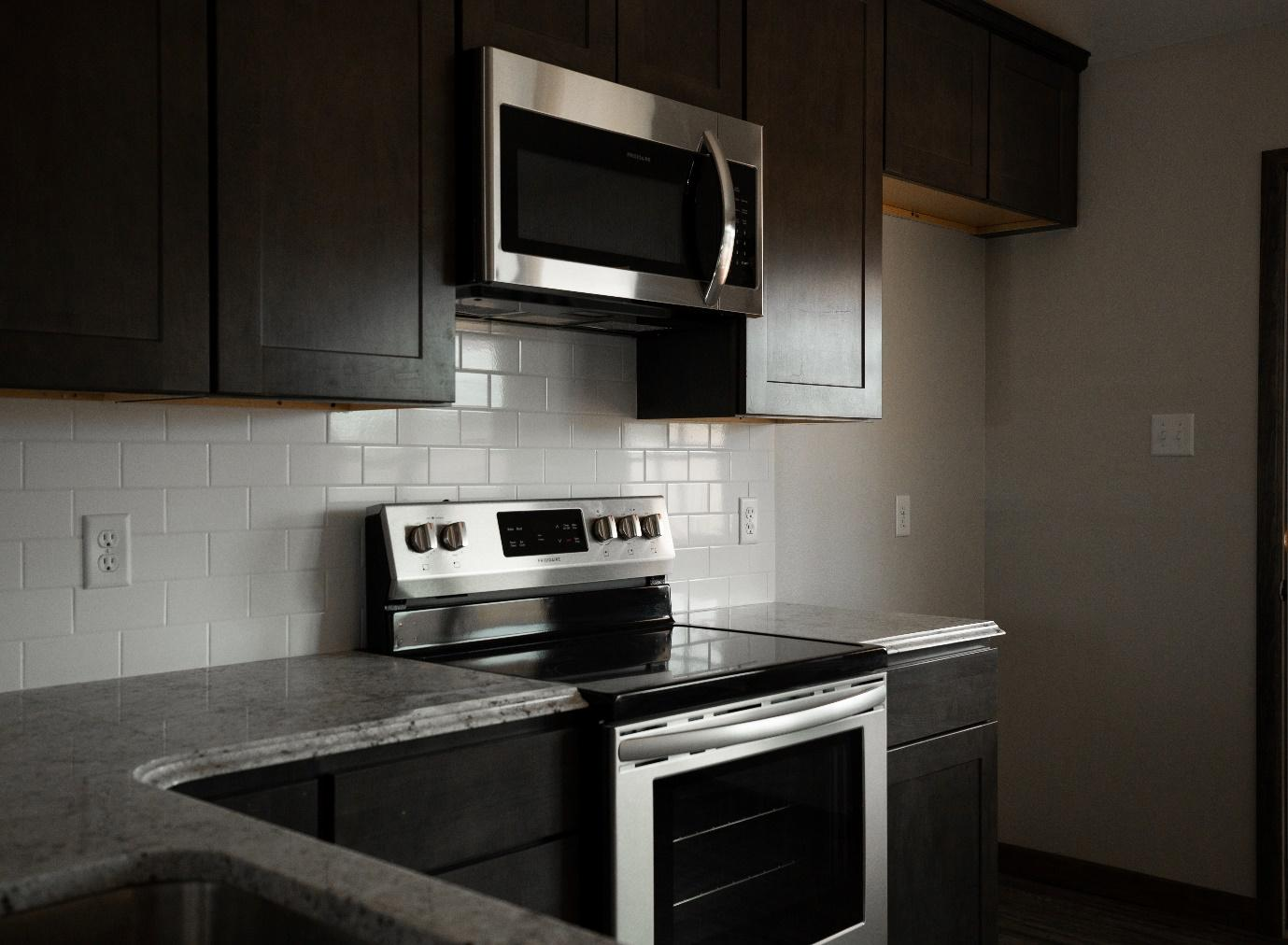 A stove top oven sitting inside of a kitchen  Description automatically generated