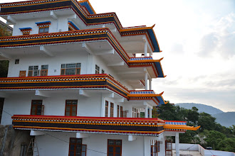 Photo: A partial side view of the newly built Sowa Rigpa Medical Institute at the Menri Monastery.