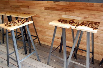 Photo: Bar stools were designed by Ferrous Studios with seats branded by sculptor John Bisbee