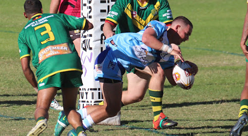 Jed Smith dives over for the Blues against Bendemeer on Sunday. However the four points that try brought with it, along with the other 76 that Narrabri scored in the 80-14 win, no longer count after Bendemeer pulled out of the top grade.