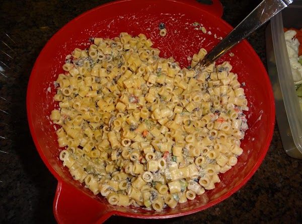 Combine pasta, pickles, olives, peppers, and onions. Pour dressing over pasta, toss, put in...