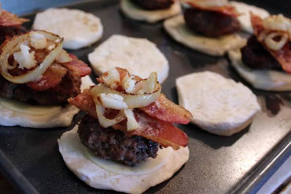 Onion and garlic on a hamburger patty.