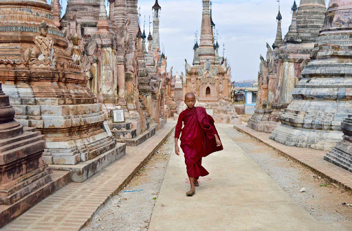 myanmar-boy-in-robe.jpg - A robe-clad novice walks through a hauntingly beautiful pagoda complex on Inle Lake in Myanmar.
