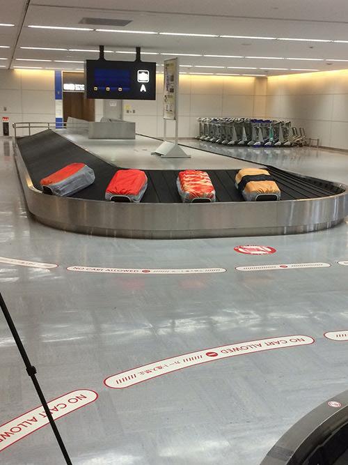 トランクレーンを流れる寿司スーツケースカバー