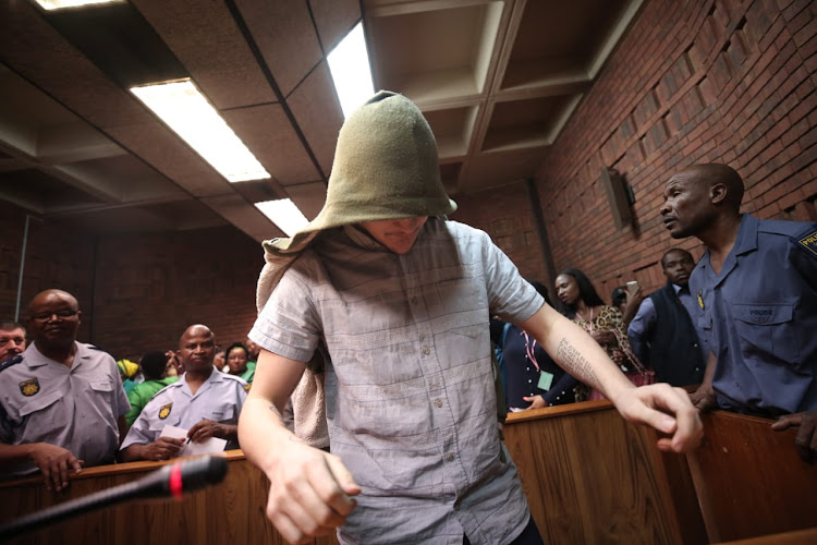 The man accused of raping a seven-year-old leaves the court room in the Pretoria Magistrate's Court on November 1 2018.