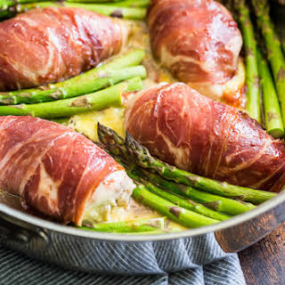 Strawberry Glazed Prosciutto Wrapped Stuffed Chicken and Asparagus.