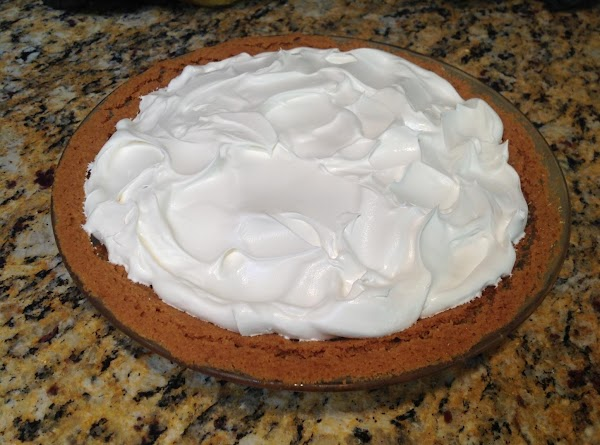 Spread the Whipped Topping over the Chopped Walnuts saving enough to decorate edges and...