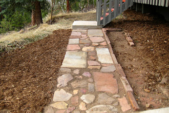Photo: Heather constructed this sidewalk all by herself! The rocks came off of our property. (The garden bed next to it is in the works)