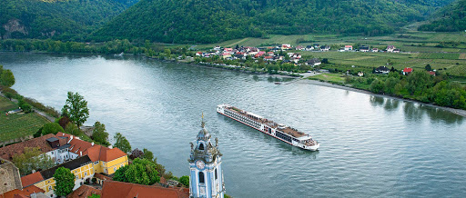 Viking Mani sails on the Rhine River past the charming historic village of Durnstein, Austria, in the Wachau region.