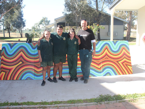 Wee Waa High School mural artists students Trekiah Cochrane, Jason-Lee Trindall and Tihana Williams and artist and heritage conservation officer from the Office of Environment and Heritage Steven Booby at a NAIDOC Week event last Thursday.