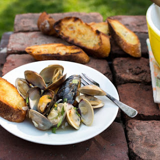 Grilled Clams and Mussels with Garlic, Almonds and Mint