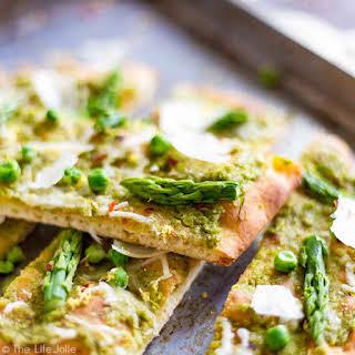 Pea Pesto Flatbread with Asparagus and Shaved Pecorino Romano.