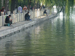 Photo: Beijing - Houhai lake bank with fishermen