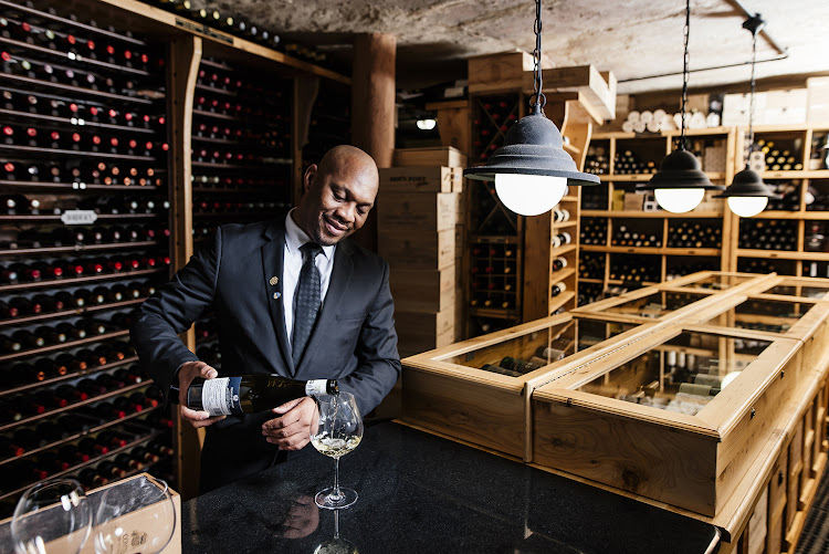 Restaurant Mosaic's award-winning sommelier Moses Magwaza in the eatery's famous wine cellar.