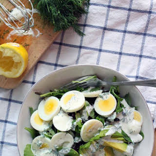Mixed Green Salad with Egg, Avocado, and Creamy Lemon-Dill Dressing.