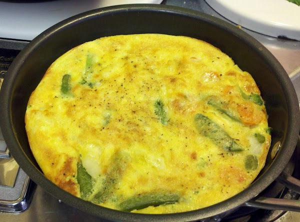 Preheat broiler. Top frittata with grated cheese. Place under broiler for 2-3 minutes, until...