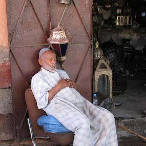 Sleeping on job by Mylene Rizzo - People Professional People ( marrakech, morroco, sleeping on job, souk, sleeping,  )