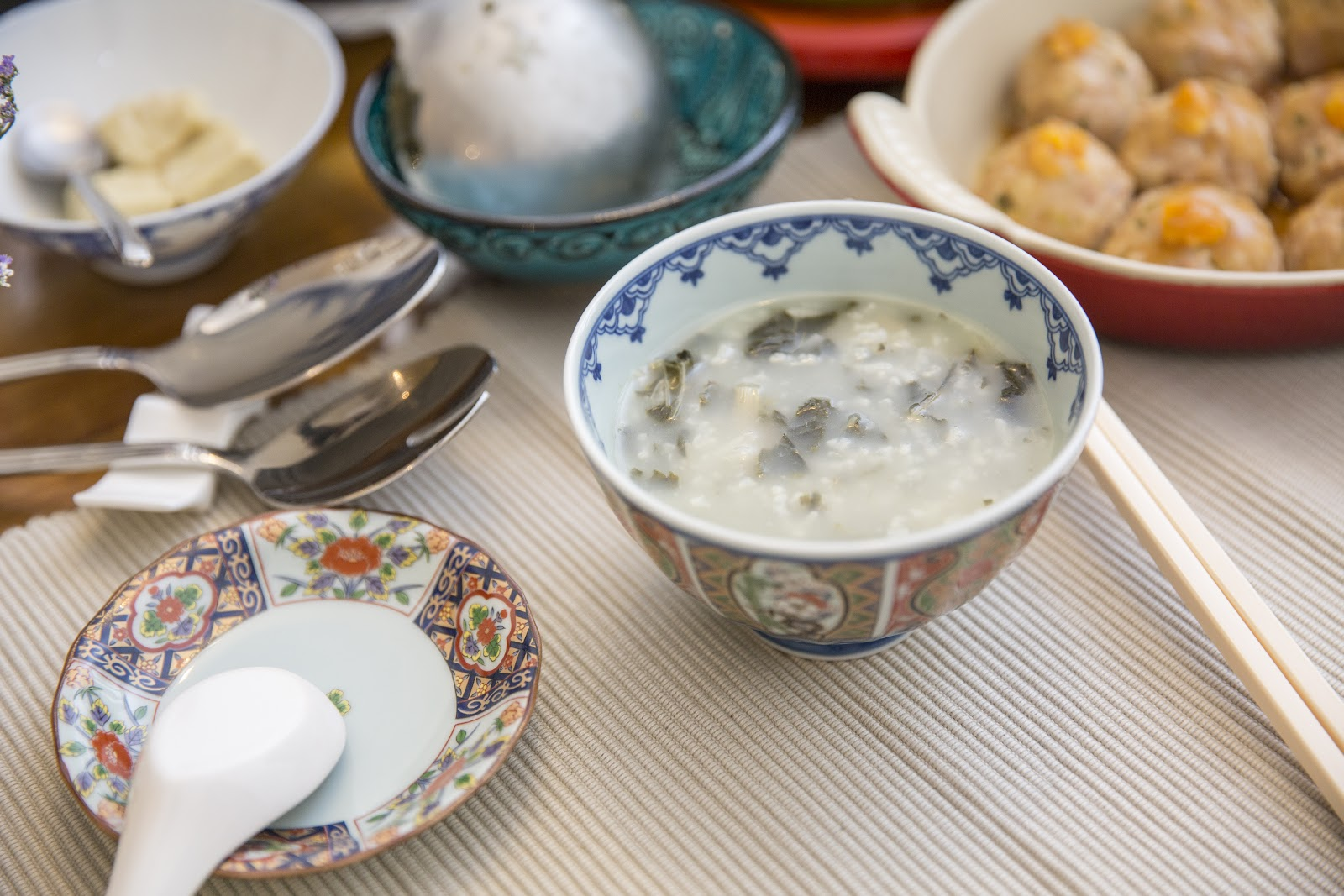 Cantonese congee, served with a myriad of side dishes