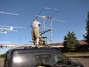 Photo: Terry W8ZN cleans antennas of leaves