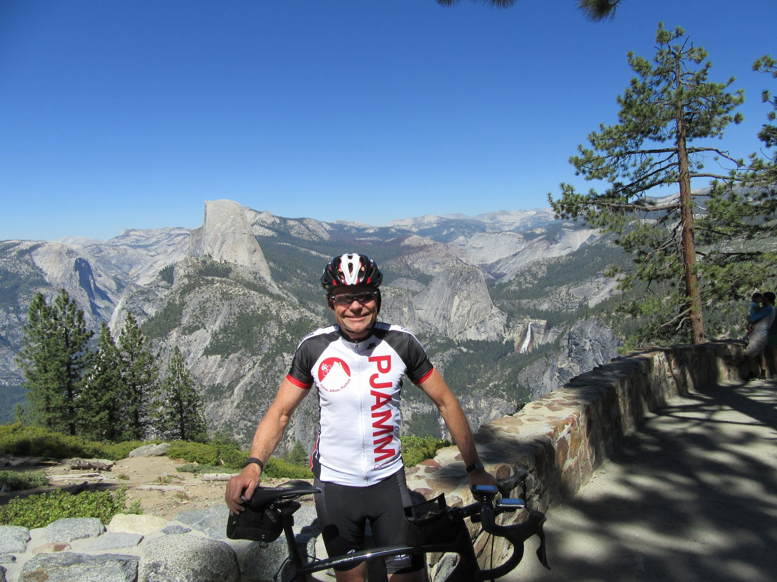CyclingTop US Bike Climbs - PJAMM cyclist with bike at Glacier Point, Yosemite National Park - Half Dome, Nevada Falls