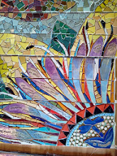 """Photo: Saturday, July 20, 2013 Hidden Garden Steps ceramic-tile mosaic preview at St. John of God community hall in San Francisco's Inner Sunset District: Detail of the top half of the 14-step Passion Flower, designated as """"The Gratitude Element"""" on the Steps to honor key community partners who supported the Hidden Garden Steps through donations of materials and services. This section will be directly above the large landing on the top third of the Steps. Project artists Aileen Barr and Colette Crutcher completed the Passion Flower as part of the 148-step mosaic to be installed on 16th Avenue, between Kirkham and Lawton streets in San Francisco. For more information about the Hidden Garden Steps project, please visit http://hiddengardensteps.org."""