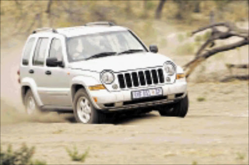TOUGH: Driver claims it costs a lot to service a Jeep Cherokee. Cicra 2009. Pic. Unknown.