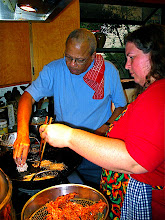 Photo: Bill dropping taro mixture into oil while Becky fries