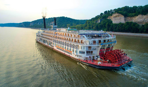 The 436-passenger American Queen rolls along on the Mississippi River.