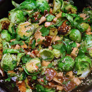 Sweet and Spicy Brussels Sprouts with Tofu and Shiitake Mushrooms.