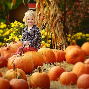 The Great Pumpkin Patch by Sandra Hilton Wagner - Babies & Children Child Portraits ( child, orange, pumpkin patch, girl, fall, pumpkins, blond, autumn colors, yellow, flowers,  )