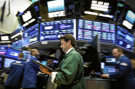 Traders work on the floor of the New York Stock Exchange. Picture: REUTERS