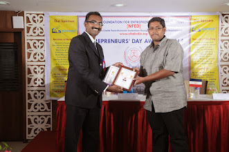 Photo: Guest of Honour Mr. Bobby A. Mathew Issuing Young Entrepreneur Award to Managing Partner, Ayushmaan Solar Enterprises, Coimbatore